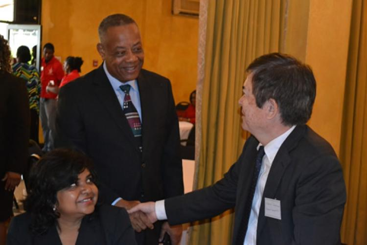 Honourable Derrick Kellier, Minister of Labour & Social Security, left, greeted Mr. Masami Shukunobe