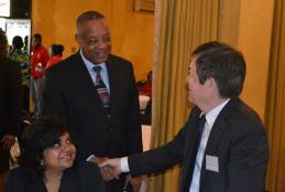 Honourable Derrick Kellier, Minister of Labour & Social Security, left, greeted Mr. Masami Shukunobe